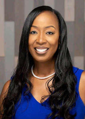 """a woman smiling for the camera: Wyonna Baldwin, a real estate broker in McCalla, Ala., says sellers know that """"buyers are grasping at straws"""" and the lack of inventory and high home prices are contributing to higher rents."""