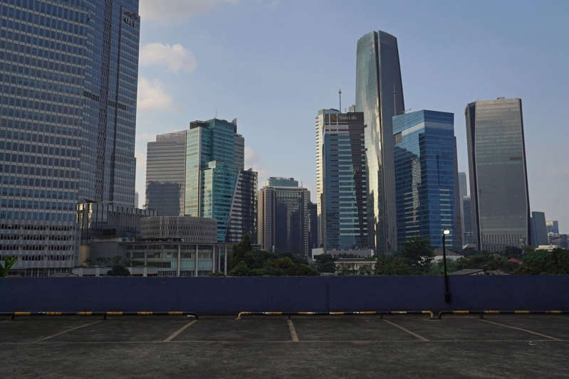 a tall building in a city: A deserted car park in the central business district of Jakarta on August 4. Indonesia pulled out of a recession in the second quarter but the rise in coronavirus cases and the mobility restrictions threaten the recovery momentum in the third quarter. Photo: Photo: Bloomberg