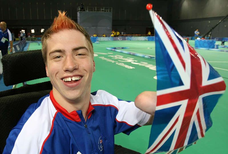 David Smith in a striped shirt and smiling at the camera: Great Britain's David Smith celebrates winning gold (Julien Behal/PA) (PA Archive)