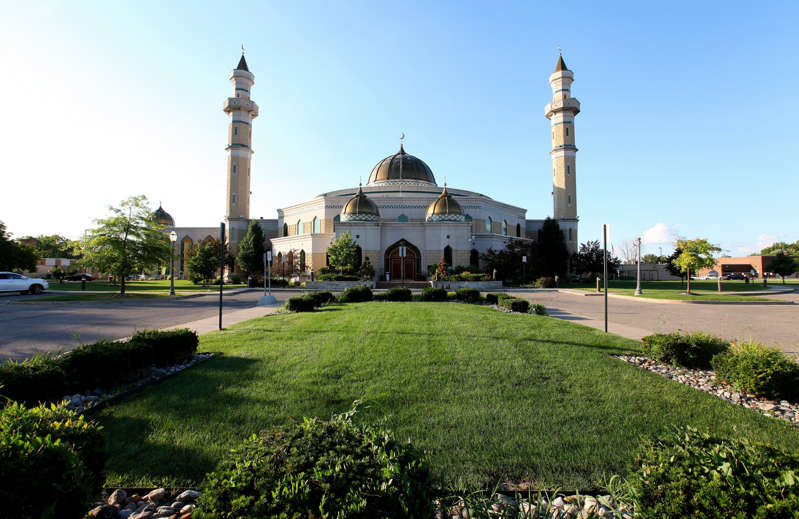 a large building with grass and trees: Islamic Center Of America on July 17, 2014 in Dearborn, Michigan. Raymond Boyd/Getty