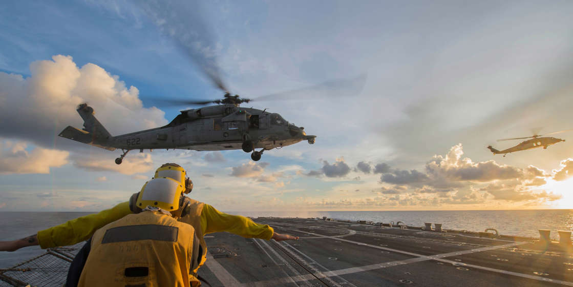a group of clouds in the sky: An MH-60S Sea Hawk helicopter. Not the one that crashed. Mass Communication Specialist 3rd Class Elesia K. Patten/US Navy