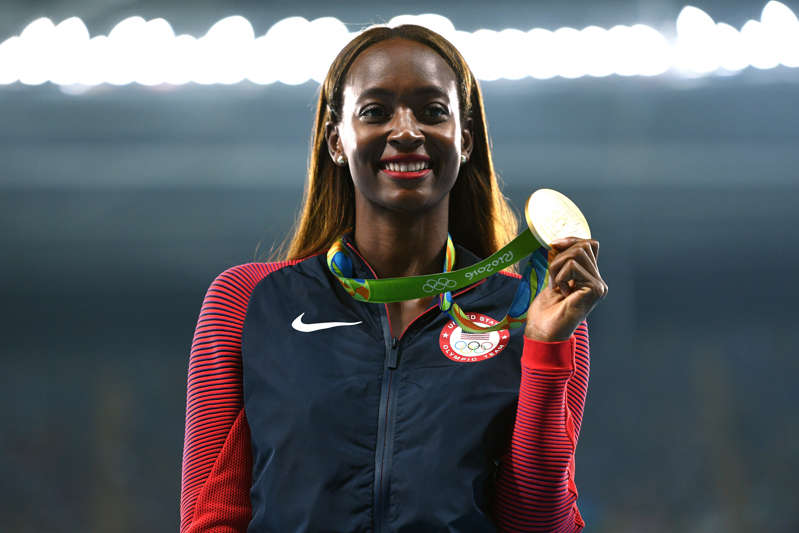 Dalilah Muhammad wearing a costume posing for the camera: Gold medalist, Dalilah Muhammad of the United States, poses on the podium during the medal ceremony for the Women's 400m Hurdles on Day 14 of the Rio 2016 Olympic Games at the Olympic Stadium on August 19, 2016 in Rio de Janeiro, Brazil. David Ramos/Getty