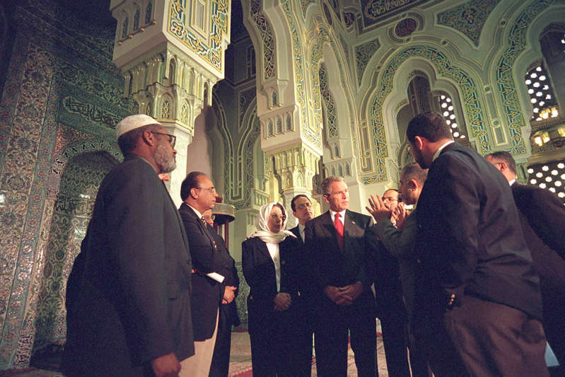 George W. Bush et al. standing in front of a crowd: U.S. President George W. Bush meets with Muslim leaders September 17, 2001 after touring the Islamic Center of Washington, DC. Paul Morse/White House/Getty