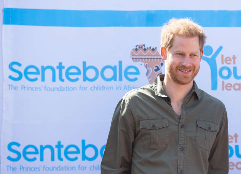 Prince Harry standing in front of a sign: The Duke of Sussex has spoken out against vaccine hesitancy (PA) (PA Archive)