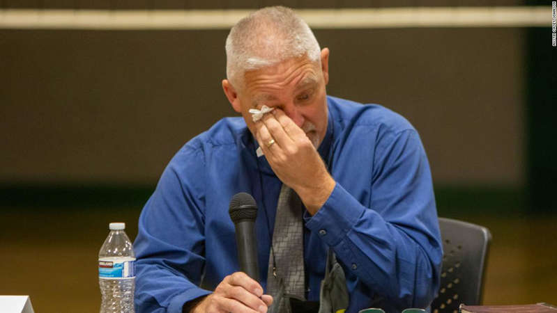 a man talking on a cell phone: Kevin Purnell grew emotional as he said goodbye to the community after he was fired.