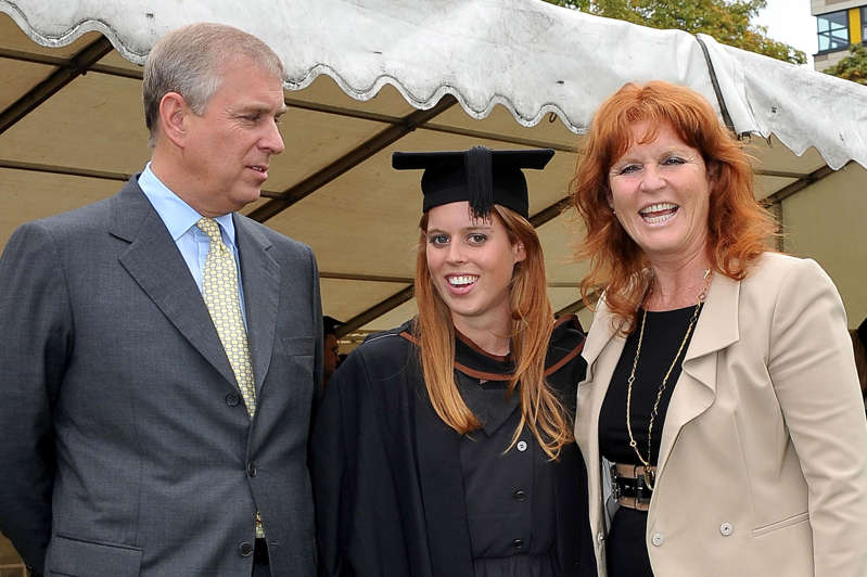 Prince Andrew, Duke of York, Princess Beatrice of York, Sarah Ferguson that are dressed up and posing for the camera:  (PA Wire)