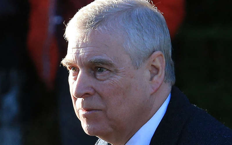 Prince Andrew, Duke of York wearing a suit and tie: Prince Andrew, Duke of York - LINDSEY PARNABY/AFP via Getty Images