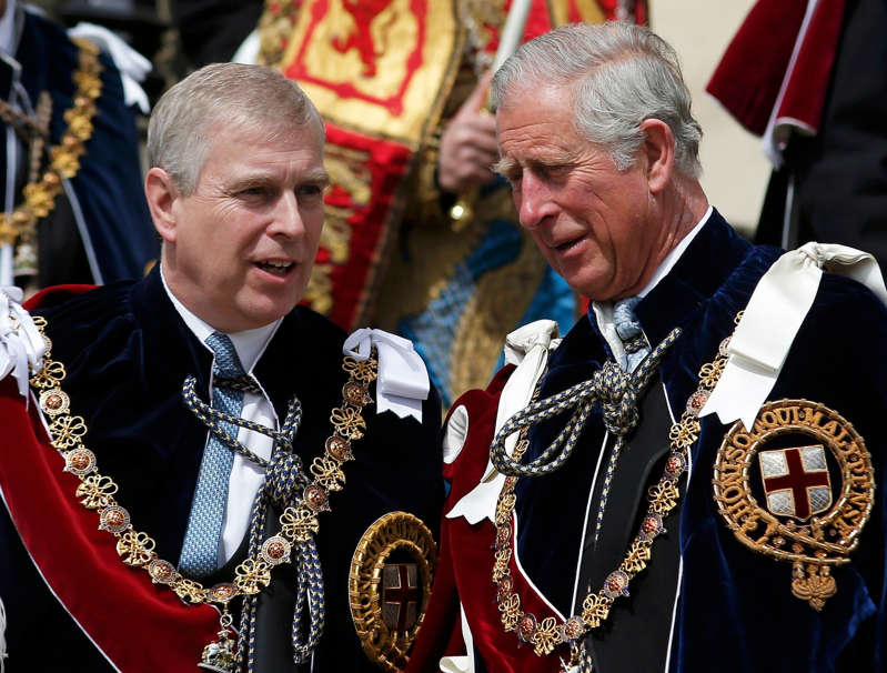 Prince Andrew, Duke of York wearing a suit and tie standing in front of a crowd:  (PA Archive)