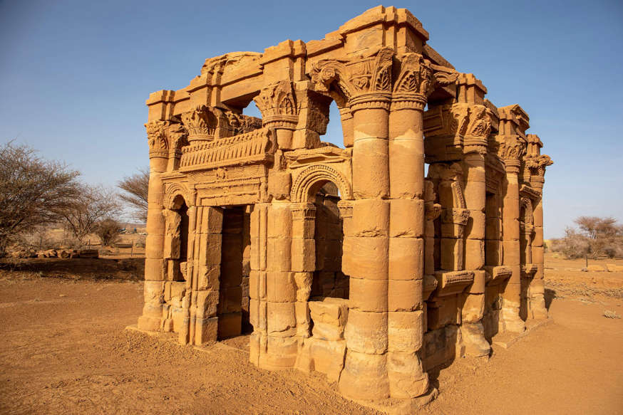 a person standing in front of Temple of Kom Ombo: Naqa, Meroe, Sudan (Shutterstock)