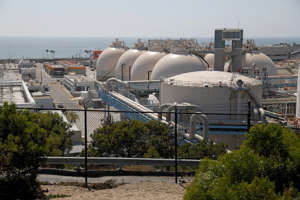 a building next to a fence: The Hyperion Water Reclamation Plant suffered a damaging flood of raw sewage last month. (Gary Coronado / Los Angeles Times)