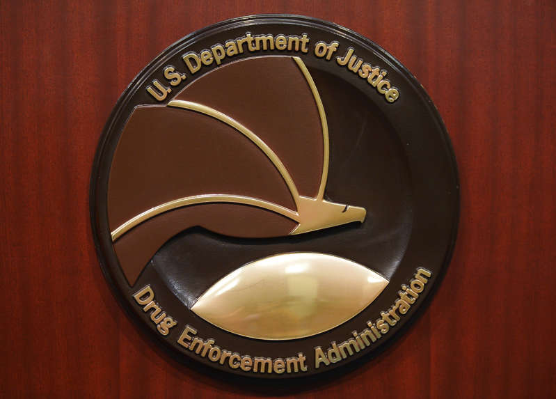 """U.S. District Judge Jane Triche Milazzo said the longtime agent, Chad A. Scott, caused """"far reaching"""" damage """"to the administration of justice."""" The seal of the Drug Enforcement Administration is seen on a lectern before the start of a press conference at DEA Headquarters on June 26, 2013 in Arlington, Virginia. Mandel Ngan/Getty Images"""