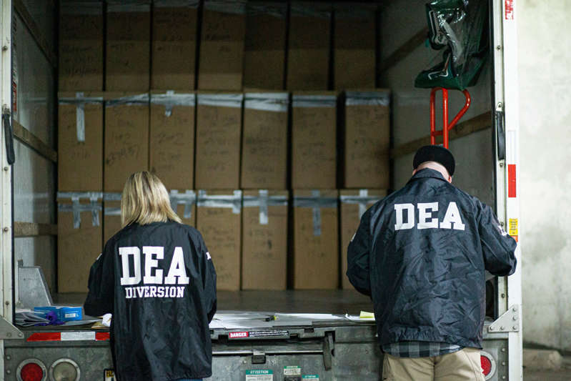 A former Drug Enforcement Administration agent was sentenced to 13 years in prison for stealing money from suspects, falsifying government records and committing perjury during a federal trial. Prescriptions drugs collected during the Drug Enforcement Administration (DEA)s Take Back Day event are placed into plastic bags by members of the DEA in White Plains, New York on April 24, 2021.