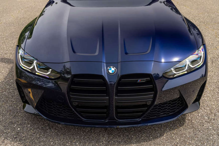 a car parked in a parking lot: 2021 BMW M3 Competition