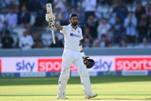 Lokesh Rahul standing in front of a crowd of people watching a baseball game: Image