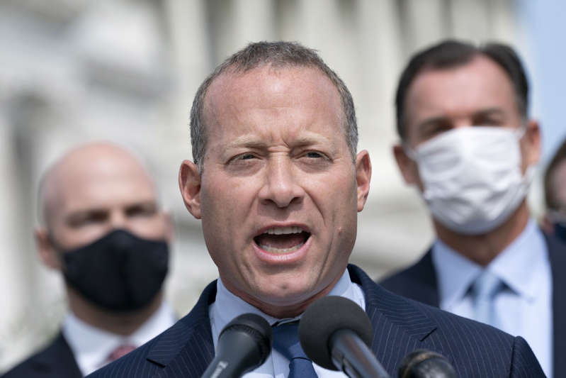Josh Gottheimer wearing a suit and tie: House Moderates To Release Bipartisan Stimulus Compromise