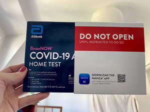 text: Natalie Compton's at-home rapid test she packed for her trip to France in July.