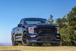 a car parked on a dirt road: 2021 Shelby F-150 Super Snake Sport