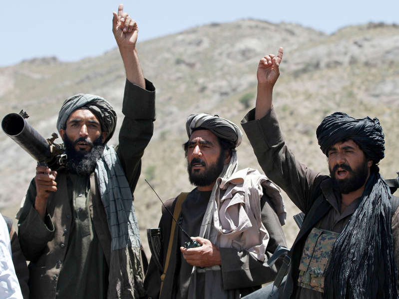 a group of people standing around each other: Taliban fighters have been seizing territory across Afghanistan. Allauddin Khan/AP
