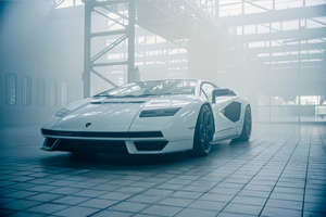 a car parked on the side of a building: 2021 Lamborghini Countach LPI 800-4 Unveiled With 800-hp Output - Return of the Icon