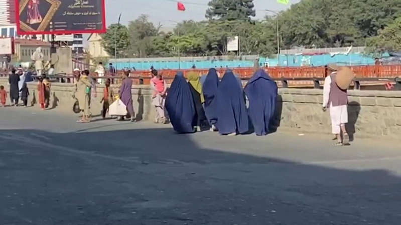 a group of people walking down the street: Women on the streets of Kabul over the weekend