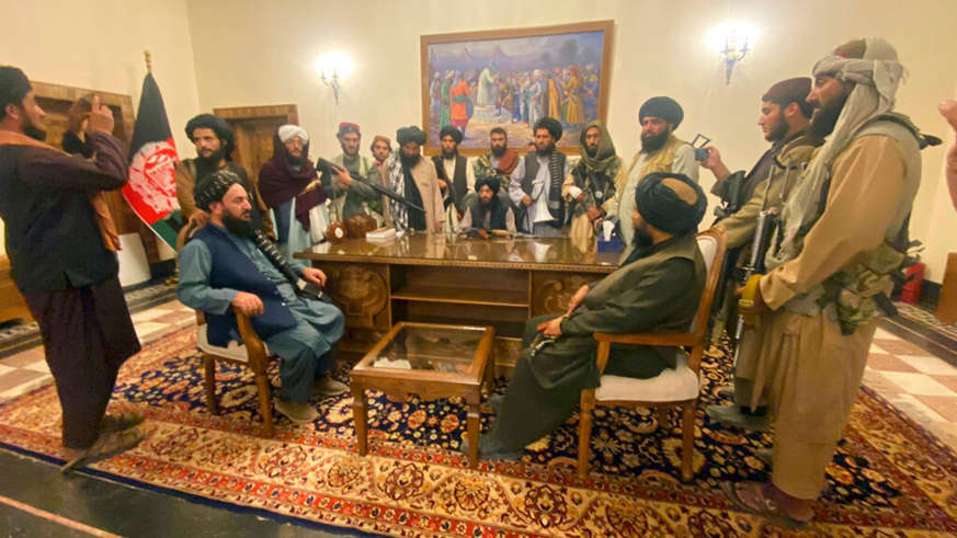 a group of people standing in a room: A Taliban spokesman claims women will 'lose nothing' under the group's regime. Pic: AP