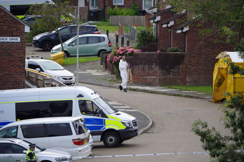 A forensic officer carries an evidence bag in Biddick Drive (Ben Birchall/PA) (PA Wire)