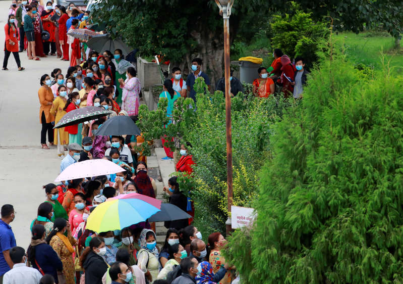 People wait in a queue to get a dose of Chinese Sinopharm vaccine against the coronavirus disease (COVID-19) in Kathmandu, Nepal, July 13, 2021. REUTERS/Navesh Chitrakar