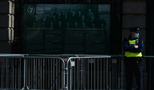 a man standing in front of a fence: Government plans to reopen the country after imposing one of the harshest lockdown regimes in the EU have the support of most voters. Pic: Artur Widak/NurPhoto via Getty Images