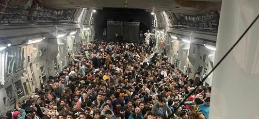 More than 600 Afghans squeeze onto a US evacuation flight out of Kabul on Sunday, 15 August, 2021 (Courtesy of US Defense Department via Defense One)