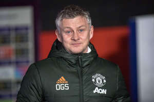Ole Gunnar Solskjaer smiling for the camera: Ole Gunnar Solskjaer wants to tie down five Manchester United players (Picture: Getty)