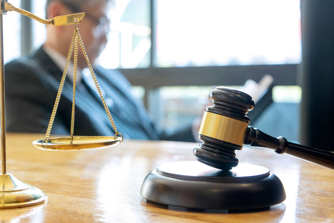 a close up of a device: A convenience store owner in Pittsburgh, Pennsylvania was sentenced to 10 years in prison on Tuesday for conspiring to sell cocaine out of his market. This is a stock image of a judge's gavel and balance scale.