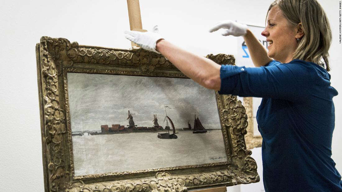 """a person standing in front of a mirror posing for the camera: """"The Voorzaan and the Westerhem"""" pictured in 2015, after the Zaans Museum purchased it for almost $1.4 million."""