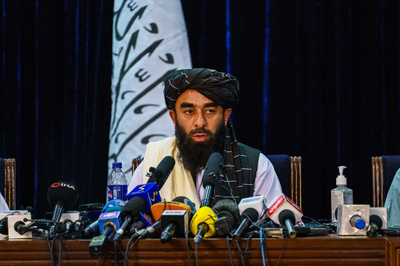 KABUL, AFGHANISTAN -- AUGUST 17, 2021: Zabihullah Mujahid, the Taliban spokesman for nearly 2 decades who worked in the shadows, makes his first-ever public appearance to address concerns about the Taliban' reputation with women's education, appearance and rights, television music and executions, during a press conference in Kabul, Afghanistan, Tuesday, Aug. 17, 2021.