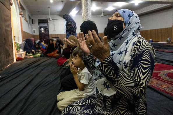KABUL, AFGANISTAN - AUGUST 13 : Displaced Afghan women and children from Kunduz pray at a mosque that is sheltering them on August 13, 2021 in Kabul, Afghanistan.