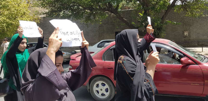 KABUL, AFGHANISTAN - AUGUST 17: Afghan women, holding placards, gather to demand the protection of Afghan women's rights in front of the Presidential Palace in Kabul, Afghanistan on August 17, 2021.