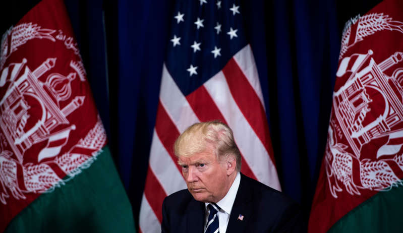 """Donald Trump wearing a suit and tie: US President Donald Trump waits for a meeting with Afghanistan's President Ashraf Ghani at the Palace Hotel during the 72nd United Nations General Assembly on September 21, 2017 in New York City. Former President Donald Trump has claimed that the U.S. is """" being set up by"""" the Taliban, days after the military organization in Afghanistan took control of Kabul following orders for American troops to leave the region."""
