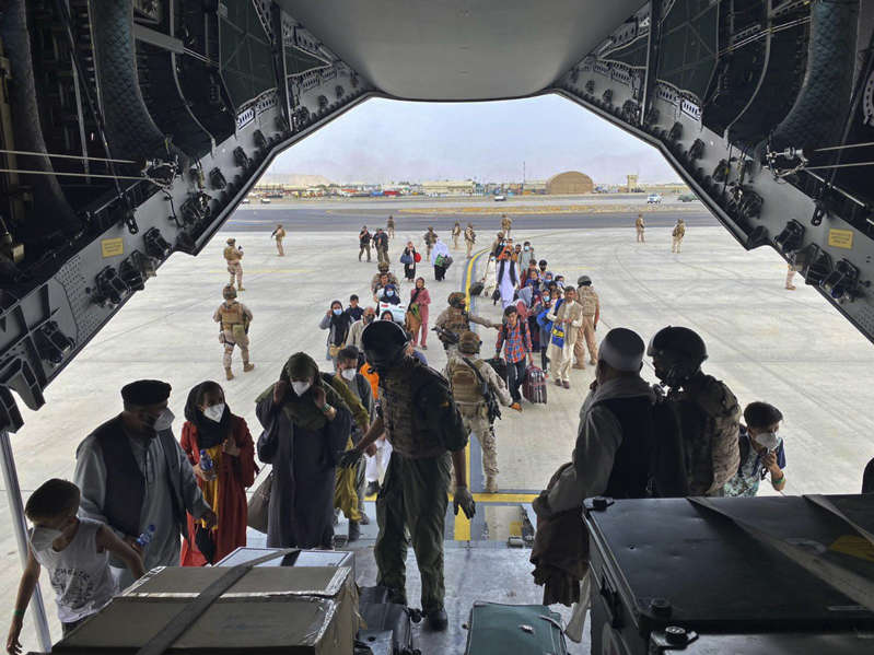 In this photo provided by the Spanish Defence Ministry and taken in Kabul, Afghanistan, people board a Spanish airforce A400 plane as part of an evacuation plan at Kabul airport in Afghanistan, Wednesday Aug.18, 2021. (Spanish Defence Ministry via AP)