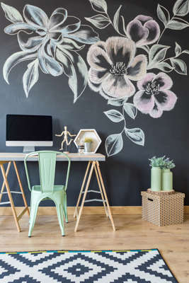 A mural of flowers on the wall is an original way to elevate any room.