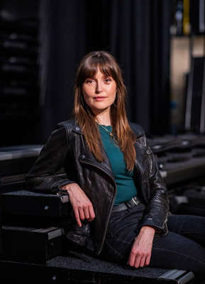 a woman sitting on a bench: Kin actor Clare Dunne at RTÉ's new season launch. Pic: Naoise Culhane