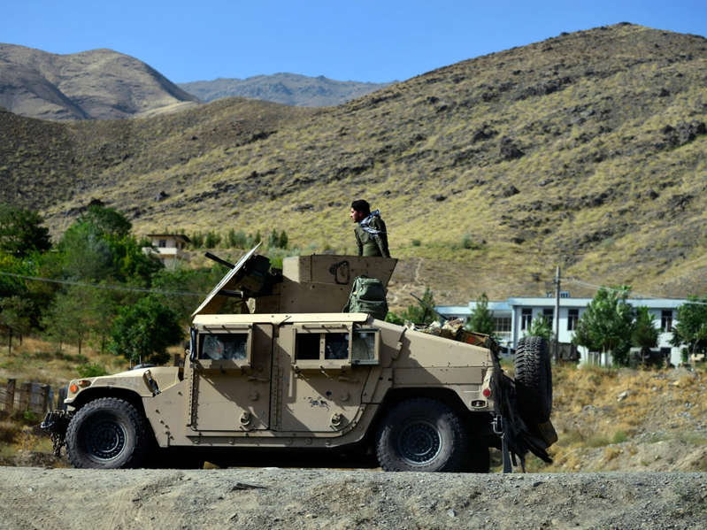 a truck is parked on the side of a mountain: Afghan security forces patrol in a Humvee in Panjshir on 17 August - Sahel Arman/AFP via Getty Images