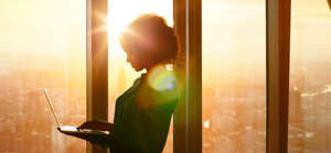 a person sitting in front of a window: 7 Ways to Become a Business Leader That People Are Excited to Follow