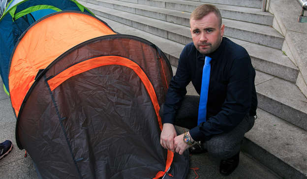 a man sitting in a tent: Mr Flynn, 35, founded the charity Inner City Helping Homeless (ICHH) in 2013 after working with youth communities in Dublin. Pic: Gareth Chaney/Collins Photos