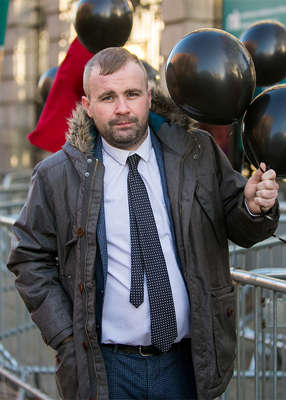 a man wearing a suit and tie: Dublin city councillor and homelessness campaigner Anthony Flynn has been found dead in tragic circumstances. Pic: Gareth Chaney/Collins Photos