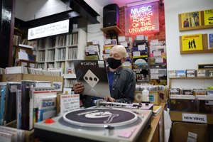 Karl Shale with a copy of the newly released album 'McCartney III' by Paul McCartney, in the Sounds of Universe record store in London, December 2020 (AFP/Getty)