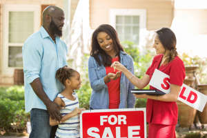 a group of people looking at a sign: 1 Real Estate Growth Stock to Buy Right Now