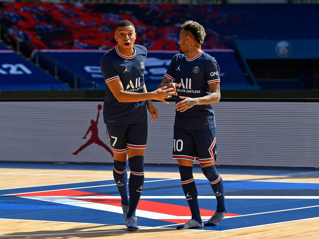 a group of people on a court: The Air Jordan logo first appeared on the PSG kits in 2018. Aurelien Meunier - PSG/PSG via Getty Images