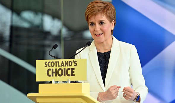 Nicola Sturgeon standing in front of a store: Independence: The Scottish First Minister is hoping to hold Indyref2 in 2023