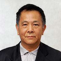 a man wearing a suit and tie: Chan Ngai Weng