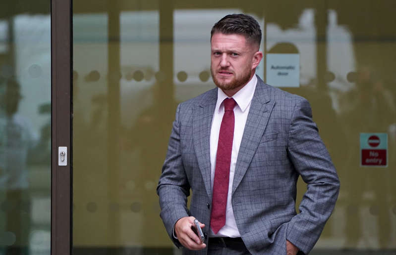 Tommy Robinson wearing a suit and tie: Tommy Robinson appeared in court accused of stalking Independent home affairs correspondent Lizzie Dearden - Stefan Rousseau/PA