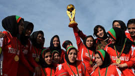 a group of people posing for the camera: The first Afghanistan women's football team was formed in 2007